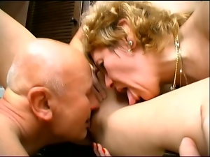 Mature lady in her daughter are sharing a cock