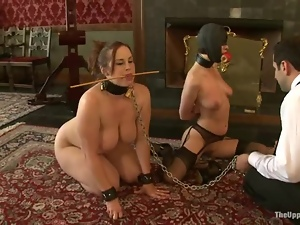 Two bonded girls in masks get their pussies and asses stretched