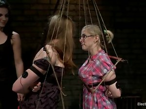 Two bound blondes get toyed and tortured with electricity