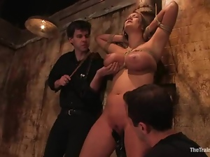 Trina Michaels enjoys being tortured by two men in a jail