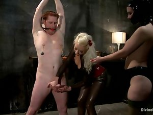 Ginger guy gets dominated by two amazing mistresses