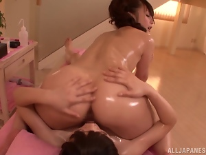 Two sexy Japanese babes are going for an oiled up sex