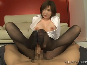 Japanese cutie Nanako Mori gives a terrific footjob and gets facialed