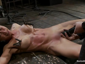Chained Tia Ling gets toyed with a vibrator on the floor