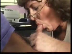 Salacious mom Leonore seduces a guy and fucks him in the office