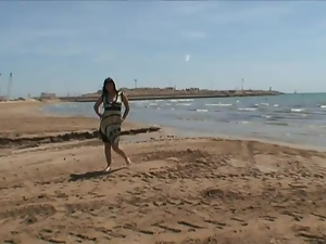 Jenny One blows on a beach and gets her pussy and ass smashed