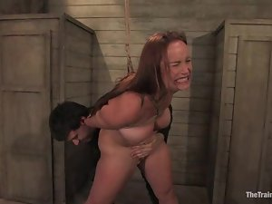 Bella Rossi gets pulled by the pussy lips in BDSM scene with Wolf Hudson