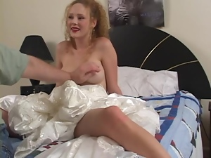Curly girl in a wedding dress sucks a dick and gets fingered