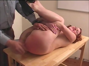 Betty gets her ass mercilessly spanked in a classroom