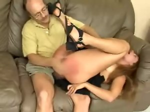 Gorgeous Jenny fingers her pussy while a man spanks her ass