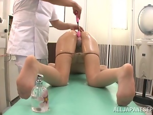 Oiled up Norika Serizaw gets her pussy fingered in a hospital