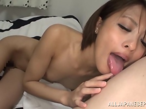 Japanese babe Yuuki Natsume rides a cock after licking it passionately