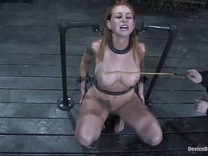 Scarlett Pain enjoys being beaten and fucked with toys in BDSM scene