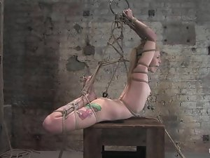 Tattooed blonde gets tied up and tortured in BDSM scene