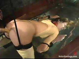 Audrey Leigh moans with pleasure while being tortured in BDSM scene