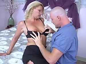 Luscious blond milf is doing a great work on his cock