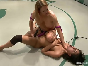 Two pretty lesbians enjoy wrestling and banging on tatami