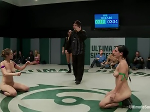 Three nasty sluts wrestle in a ring and lick pussies