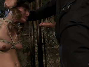 BDSM video with pigtailed Jessie Cox sucking a dick