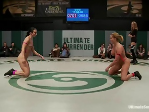 Lesbians finger each other's pussies while wrestling on tatami