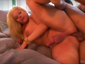 Big-assed blonde tranny Holly Sweet blows and gets fucked from behind