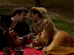 Horny couple in historical clothes have wild sex at a picnic