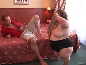 Fat midget gives a blowjob and then gets fucked on a bed