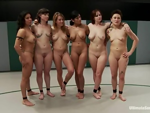 A few nude chicks have a wrestling match on tatami