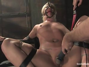 Tied up Krissy Leigh sucks a dick and gets toyed