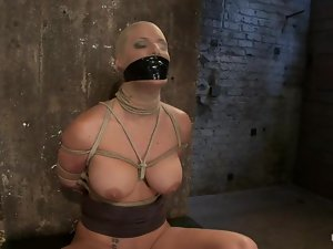Blindfolded and bondaged Phoenix Marie is loving it