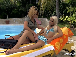 Two blonde skanks share a double dildo on the poolside
