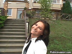 Playful brunette babe gives a blowjob to a stranger