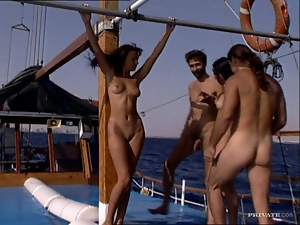 Sizzling brunette chicks get pounded on a yacht