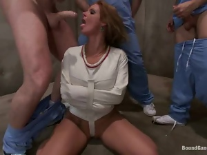 Busty milf gets her holes destroyed by three men in a weird room