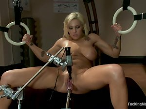Big tittied Lylith Lavey gets toyed by a machine in her wet pussy