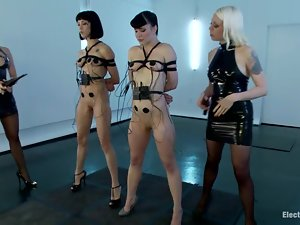Two sexy slaves get bondaged and humiliated by two cruel mistresses
