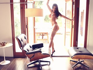 Delightful Erika Knight poses naked lying in an office table