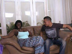Karina the busty ebony chick rides a cock in interracial video