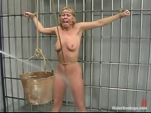 Trina gets tortured in a prison ward by a guy in military uniform