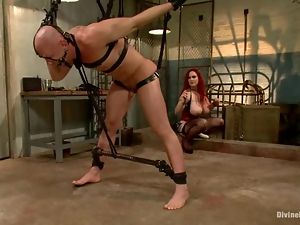 Chad Rock is hogtied and suspended so high