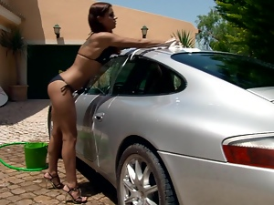 Smoking hot chick Venus is washing a damn good car