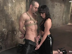 Kinky Penny Flame whips a tied up guy and toys his ass