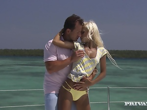 Charming and luscious blondie is riding a huge dick on the yacht