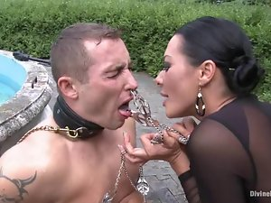 Sandra Romain the brunette mistress humiliates a guy outdoors