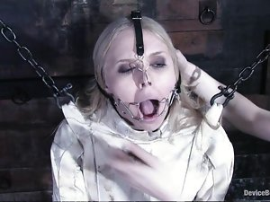 Blonde girl in straightjacket gets tied up and toyed