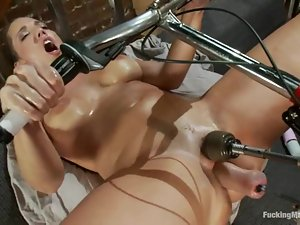 Kelly Divine fists her ass and gets it smashed by a fucking machine