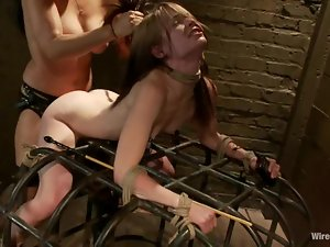 Sensi Pearl enjoys being pulled by the hair and fucked with a strapon