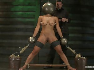 A huge iron ball is worn on Adrianna Luna's head