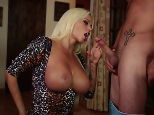 Big tittied Nikita plays the piano and gives a blowjob