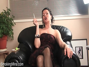 Dirty talking milf strips and smokes cigarette